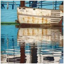 Old fishing boats in water reflection